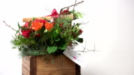 Bouquet flowers in the wooden basket video