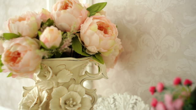 Bouquet of pink peonies in a vase on a table video