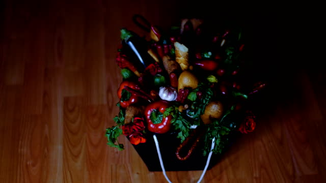 A bouquet of products stands on the floor. video