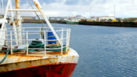 bow of old and rusty fishing boat is mooring in Grindavik, Iceland, waves of Atlantic ocean video