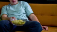 Bowl of crisps in the hands video