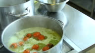 Bowl with vegetables in the kitchen, slider and racking shot video