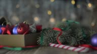 A box of Christmas decorations on an old wooden table. video