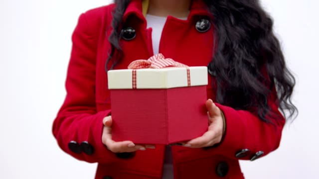 A box with a gift in the hands of a woman video