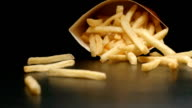 SLOW MOTION: Box with french fries falls on a table video
