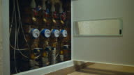 Box with water meter devices in new built residential house video