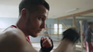 Boxer exercising without gloves in boxing gym video