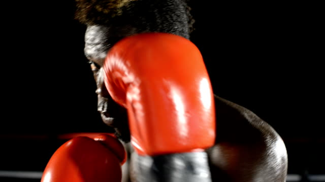 Boxer moving face and body in a defensive position video