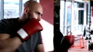 Boxer performing shadow boxing in gym video