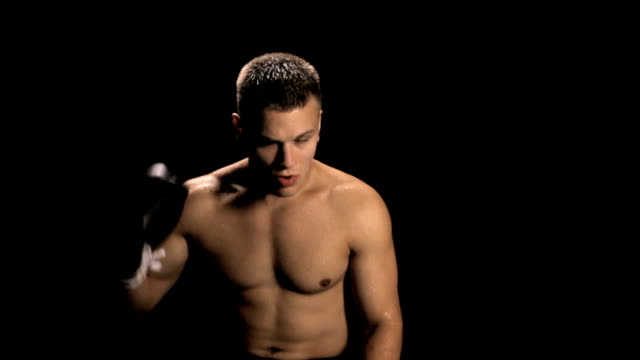 Boxer Puts in Mouthpiece (slow motion) video