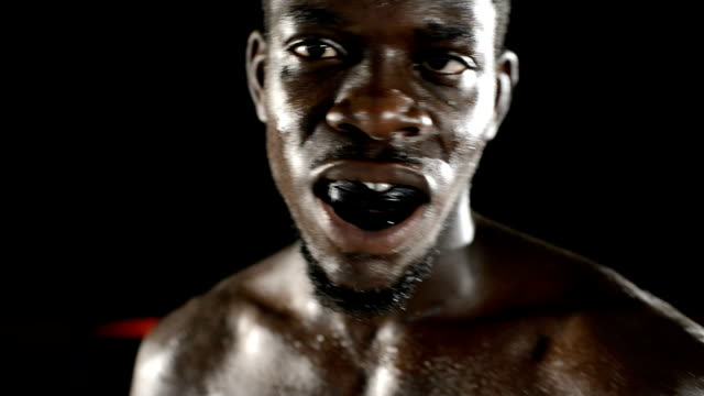 Boxer showing mouthguard video