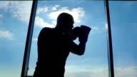 Boxer silhouette near the window video