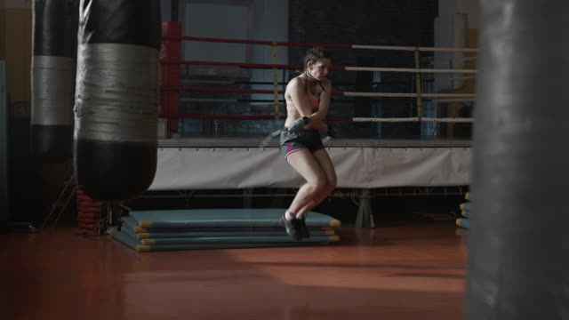 Boxer woman warm-up, jumping rope video