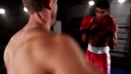 Boxers fight in boxing ring video