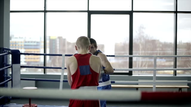 Boxers have a fight at ring in a boxing club video