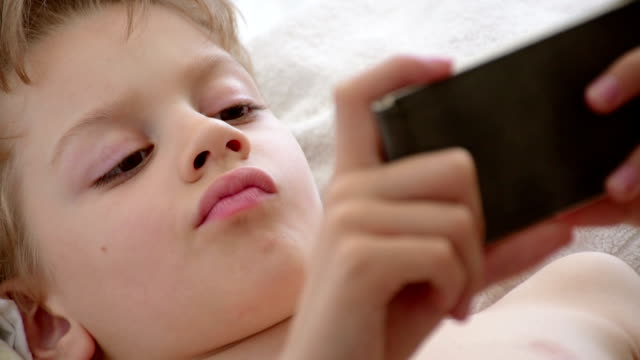 boy addicted to phone games video