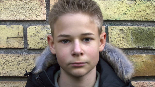 boy against a wall video