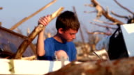 Boy alone after a natural disaster video