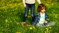 A boy and a girl on the spring meadow. video