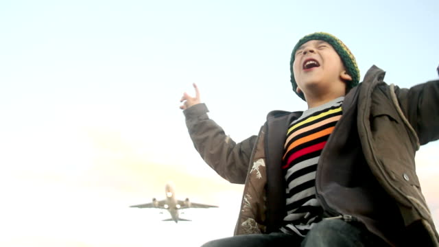 boy and airplane takeoff video