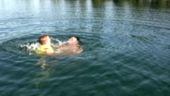 Boy and Dad Swimming video