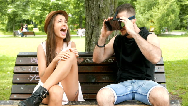 Boy and girl having fun with virtual reality goggles video