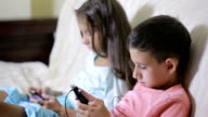 Boy and girl sitting on the couch with your phone. Online Games video