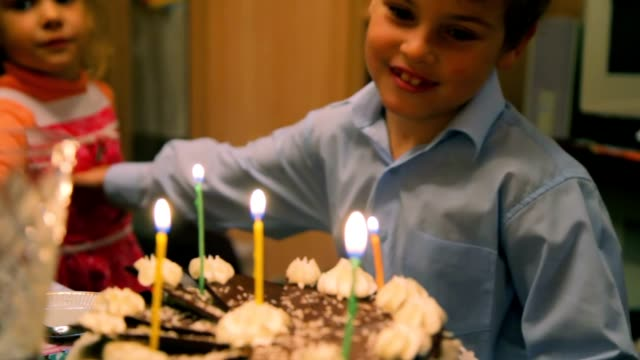 Boy and girl with birthday cake video