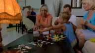 Boy and his family playing with toys at home video