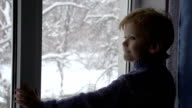 Boy and Snow Outside the Window video