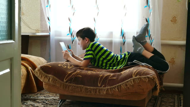 boy and tablet video