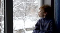 Boy and Winter Window video