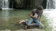 boy are taking  samples of ground of the lake  bottom - terrain -soil video