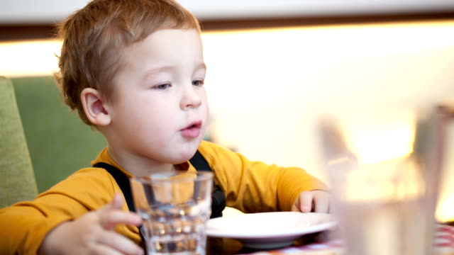 Boy at the table in cafe video