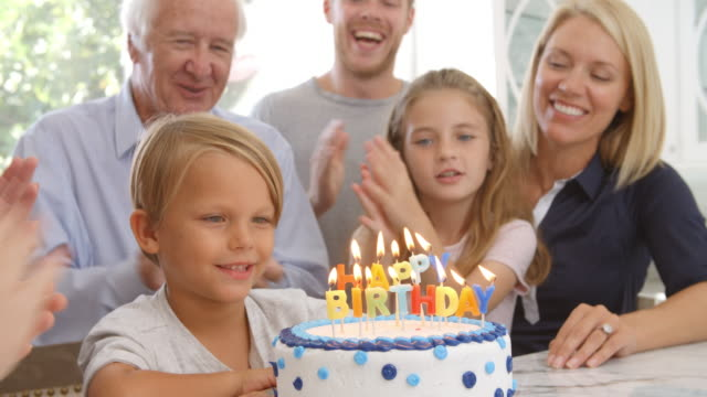 Boy Blows Out Candles On Birthday Cake, Slow Motion video