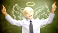 Boy businessman Christianity angel wings and halo or capitalist venture capitalist financier video