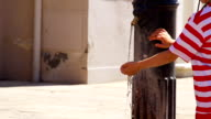 HD SUPER SLOW-MO: Boy By The Drinking Water Fountain video