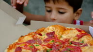 boy chooses a slice of pizza video