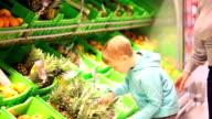 Boy choosing pineapple video