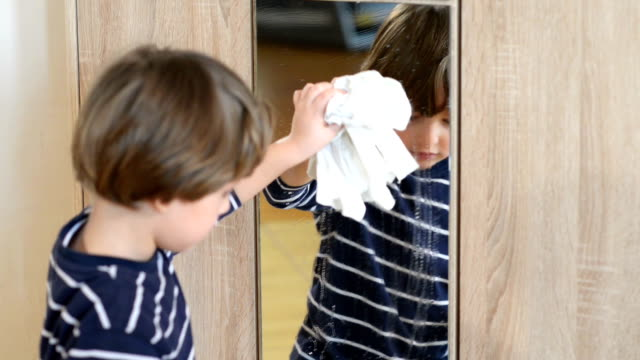 Boy Cleaning the Mirror video