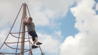 Boy Climbing on Ropes at Playground video