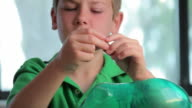 Boy Counting his Money video