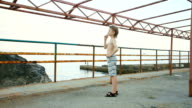 boy doing exercise on the metal structure video
