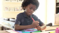 Boy Drawing Picture On Table At Home video