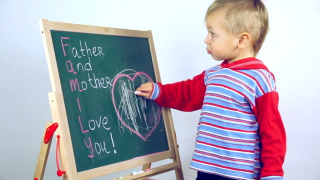 boy draws a card for parents video