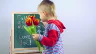 boy draws a card for parents video