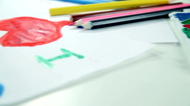 Boy Draws Paints on White Paper video