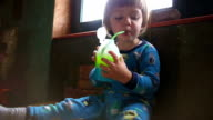 Boy Drinking Juice From Green Drinking Straw video