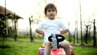Boy driving toy car video