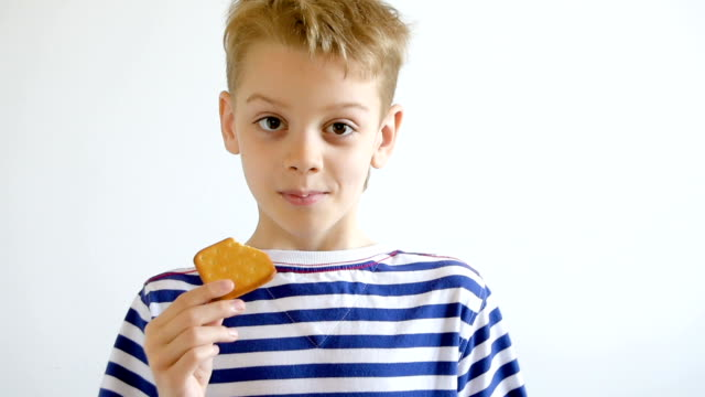 Boy eating cookies, close-up video